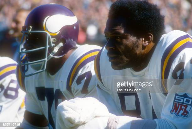 Carl Eller and Jim Marshall of the Minnesota Vikings looks on from the bench during an NFL football game circa 1969 Eller played for the Vikings...
