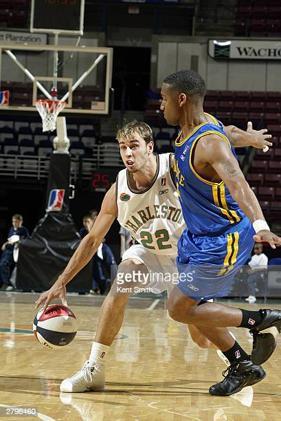 Carl English of the North Charleston Lowgators dribbles against George Williams of the Roanoke Dazzle during the game at North Charleston Coliseum on...