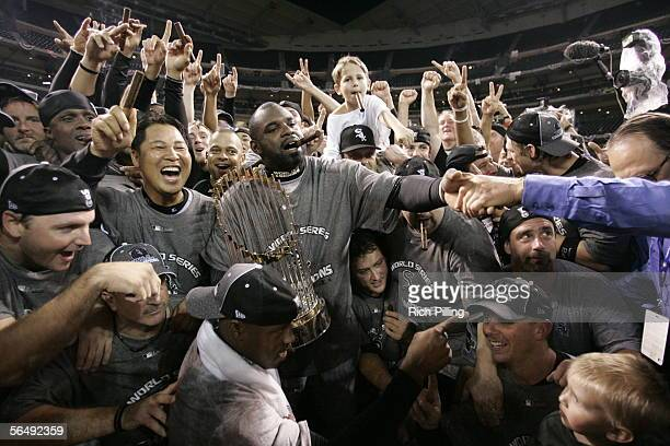 Carl Everett of the Chicago White Sox carries the World Series Trophy after winning the 2005 World Series against the Houston Astros at Minute Maid...