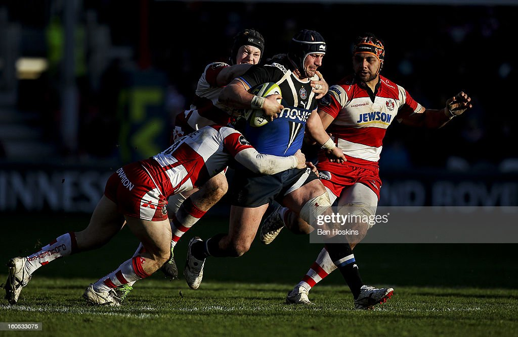 Carl Fearns of Bath is tackled by Rupert Harden of Gloucester (L) during the LV= Cup match between Gloucester and Bath at the Kingsholm Stadium on February 2, 2013 in Gloucester, England.