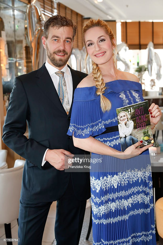 Carl Ferdinand zu Bentheim-Steinfurt and Elna-Margret zu Bentheim-Steinfurt pose during the presentation of Elna-Margret zu Bentheim-Steinfurt's book 'Eat What Makes You Glow - Anti Aging Food' on July 19, 2016 in Berlin, Germany.