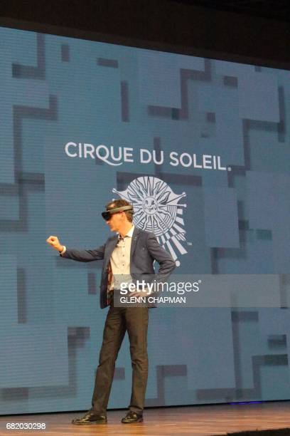 Carl Fillion of Cirque Du Soleil shows how HoloLens augmented reality gear will be used to design new shows during a Microsoft developers conference...