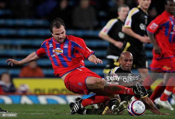 Carl Fletcher of Crystal Palace gets tackled by Trevor Sinclair of Cardiff City during the Coca Cola Championship match between Crystal Palace and...
