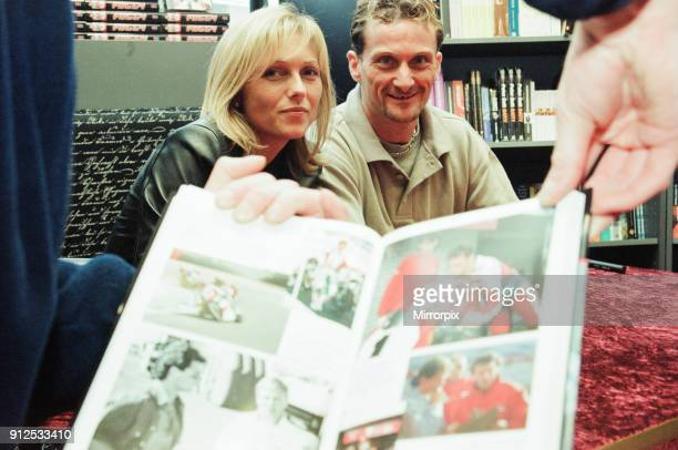 Carl Fogarty four times World Superbike Champion and wife Michaela signing copies of his autobiography Foggy Waterstones Coventry 16th November 2000