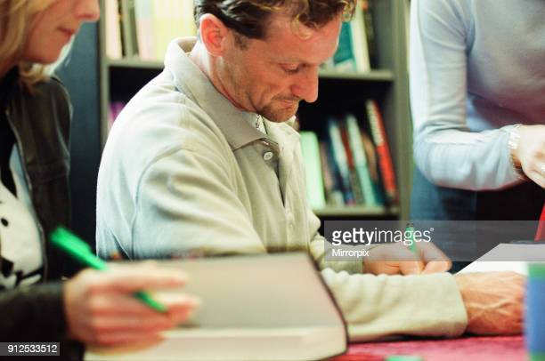 Carl Fogarty four times World Superbike Champion signing copies of his autobiography Foggy Waterstones Coventry 16th November 2000
