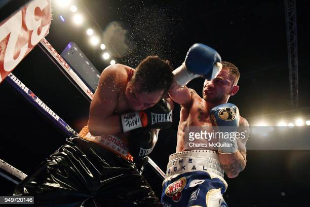 Carl Frampton and Nonito Donaire during their WBO Interim World Featherweight championship bout at SSE Arena Belfast on April 21 2018 in Belfast...