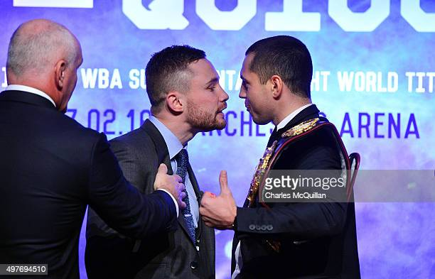 Carl Frampton and Scott Quigg are separated by Barry McGuigan as words are exchanged during the WBA and IBF superbantamweight world title unification...