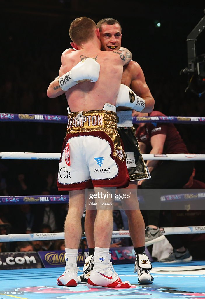 Carl Frampton and Scott Quigg (R) embrace after their World Super-Bantamweight title contest at Manchester Arena on February 27, 2016 in Manchester, England. Frampton's victory united the WBA and IBF titles.