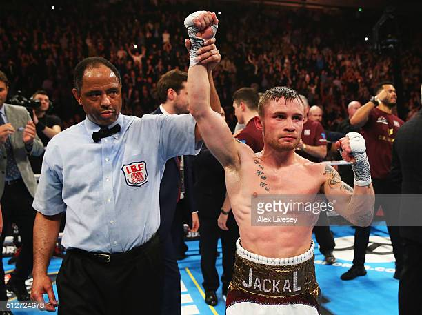 Carl Frampton celebrates a points victory over Scott Quigg after their World SuperBantamweight title contest at Manchester Arena on February 27 2016...