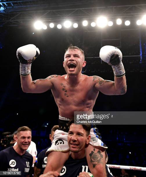 Carl Frampton celebrates after defeating Luke Jackson for the WBO interim featherweight title at Windsor Park on August 18, 2018 in Belfast, Northern...