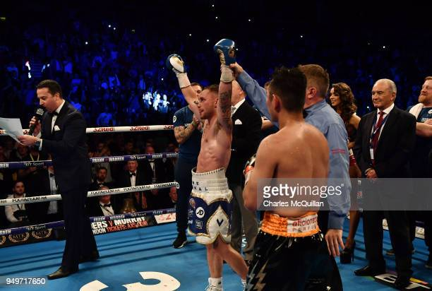 Carl Frampton celebrates after defeating Nonito Donaire following their WBO Interim World Featherweight championship bout at SSE Arena Belfast on...