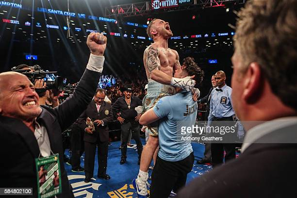 Carl Frampton celebrates his win after defeating Leo Santa Cruz in the 12 round WBA Super featherweight championship bout at Barclays Center on July...