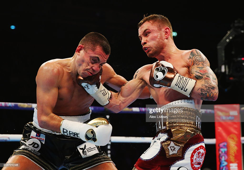 Carl Frampton (R) connects with a punch on Scott Quigg during their World Super-Bantamweight title contest at Manchester Arena on February 27, 2016 in Manchester, England.