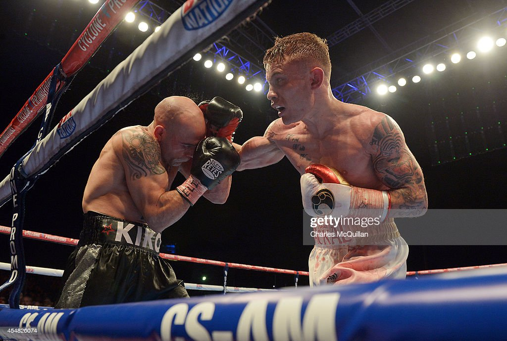 Carl Frampton of Northern Ireland lands a punch during the IBF super-bantamweight world title bout against world champion Kiko Martinez of Spain, at the purpose-built 16,000 capacity Titanic slipway outdoor arena on September 6, 2014 in Belfast, Northern Ireland. (Photo by Charles McQuillan/Getty Images).