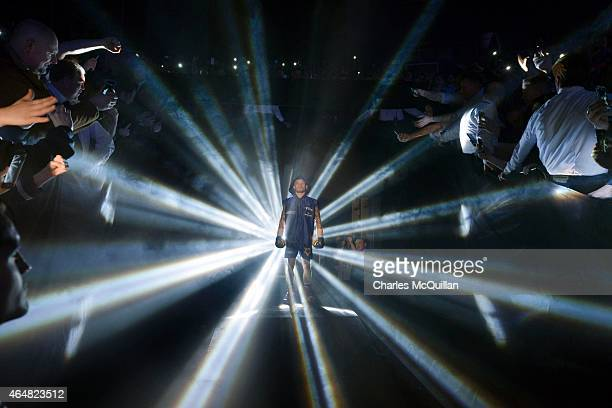 Carl Frampton of Northern Ireland makes his way into the ring before his fight with Chris Avalos of USA for the IBF Super Bantamweight World Title at...
