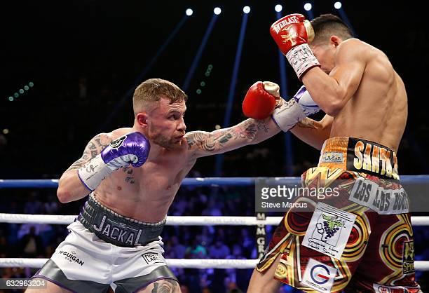 Carl Frampton punches Leo Santa Cruz during their WBA featherweight title fight at MGM Grand Garden Arena on January 28 2017 in Las Vegas Nevada Cruz...