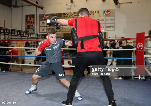 Carl Frampton works out with trainer Jamie Moore during a media work out session at on February 20 2018 in Manchester England