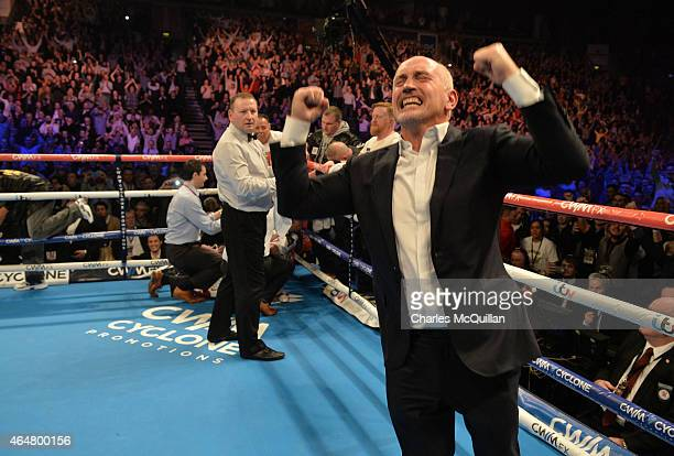 Carl Frampton's manager Barry McGuigan celebrates after Frampton's victory over Chris Avalos of USA for the IBF Super Bantamweight World Title at...