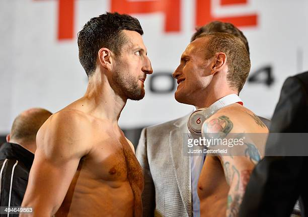 Carl Froch and George Groves square up at the Carl Froch v George Groves WeighIn at Wembley Arena on May 30 2014 in London England The WBA IBF Super...