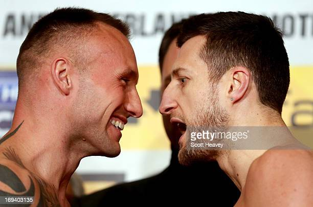Carl Froch and Mikkel Kessler during the weighin for their IBF Super Middleweight bout at the O2 Arena on May 24 2013 in London England