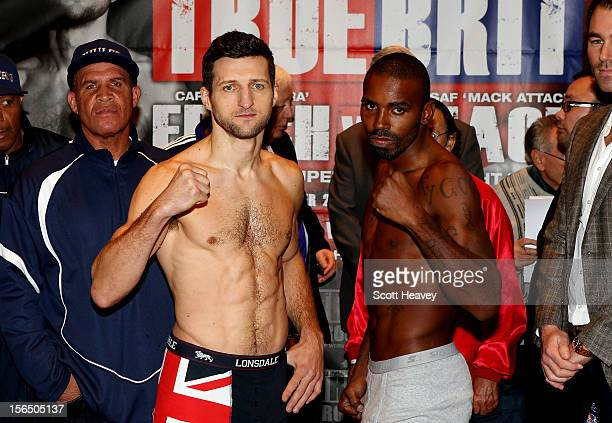 Carl Froch and Yusaf Mack face off during the weigh in at Nottingham Capital FM Arena on November 16 2012 in Nottingham England