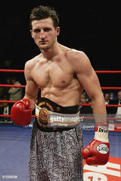 Carl Froch celebrates his victory against Mark Woolnough after their Commonwealth Super Middleweight Title fight at the Ice Arena on June 2 2004 in...