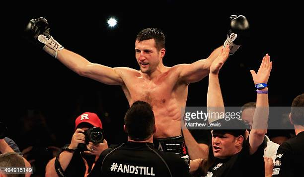 Carl Froch celebrates his win over George Groves during the IBF WBA World Super Middleweight Title Fight at Wembley Stadium on May 31 2014 in London...