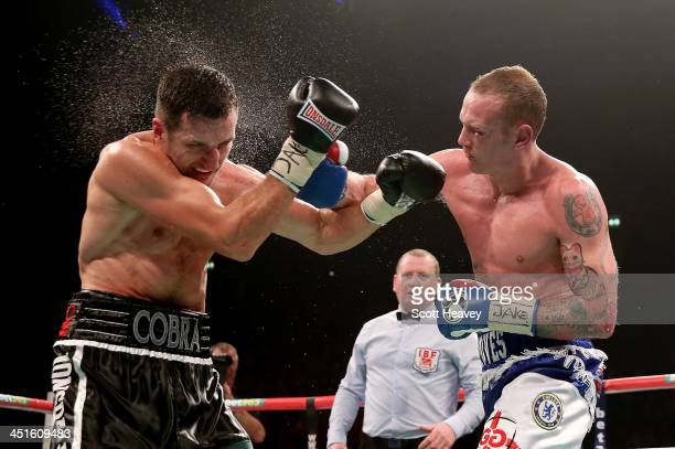 Carl Froch in action with George Groves during their IBF and WBA World Super Middleweight bout at Phones4u Arena on November 23 2013 in Manchester...