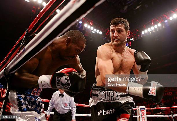 Carl Froch in action with Yusaf Mack during their IBF World Super Middleweight Title Fight at Nottingham Capital FM Arena on November 17 2012 in...