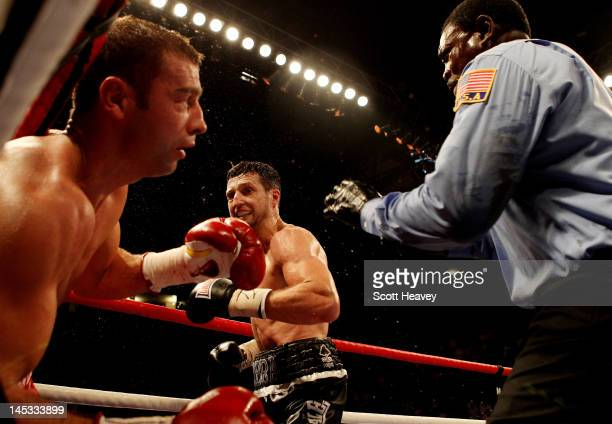 Carl Froch knockls out Lucian Bute during their IBF World Super Middleweight Title bout at Nottingham Capital FM Arena on May 26 2012 in Nottingham...