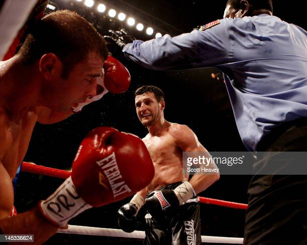Carl Froch knocks out Lucian Bute during their IBF World Super Middleweight Title bout at Nottingham Capital FM Arena on May 26 2012 in Nottingham...
