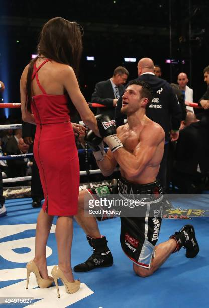Carl Froch of England celebrates his victory against George Groves of England with girlfriend Rachael Cordingley during their IBF and WBA World Super...