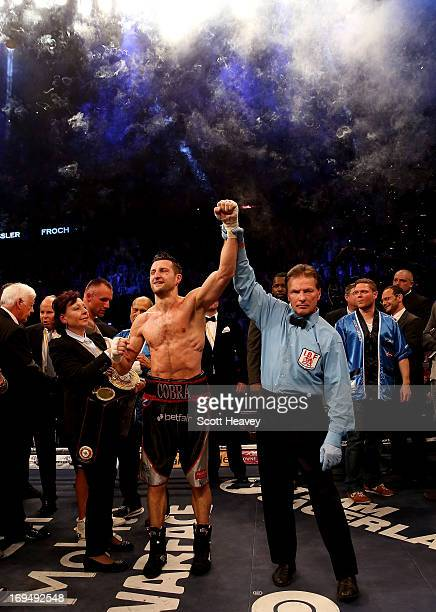 Carl Froch of England celebrates his victory over Mikkel Kessler of Denmark during their Super Middleweight Unification bout at the O2 Arena on May...