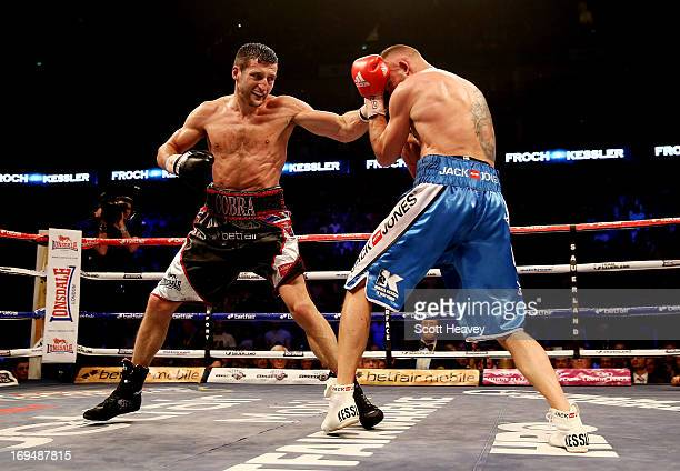 Carl Froch of England in action with Mikkel Kessler of Denmark during their Super Middleweight Unification bout at the O2 Arena on May 25 2013 in...