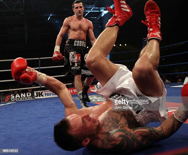 Carl Froch of England knocks down Mikkel Kessler of Denmark during their Super Six WBC Super Middleweight title fight on April 24, 2010 at MCH...