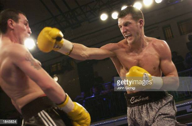Carl Froch of England throws a straight right at Varuzhan Davtyan of Armenia during the Super-Middleweight fight between Carl Froch of England and...