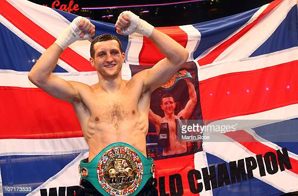 Carl Froch of Great Britain poses with the belt after winning the WBC Super Middleweight fight during the 'Super Six World Boxing Classic' night at...