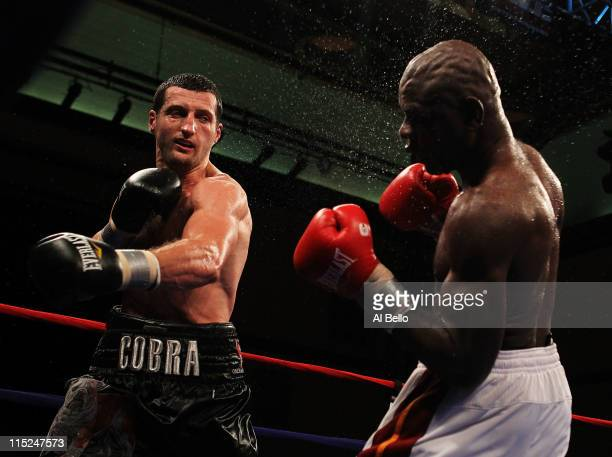 Carl Froch punches Glen Johnson during their WBC Super Middleweight title bout at Boardwalk Hall on June 4 2011 in Atlantic City New Jersey