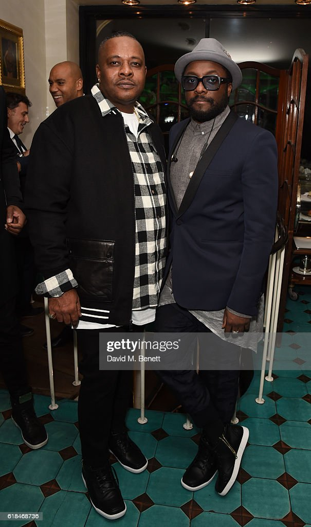 Carl Gilliam and Will.i.am attend a private dinner at Mr Chow hosted by will.i.am and brother Carl Gilliam to celebrate the launch of their luxury sneaker collection MCCVIII (TWELVEOEIGHT) at Harrods on October 26, 2016 in London, England.