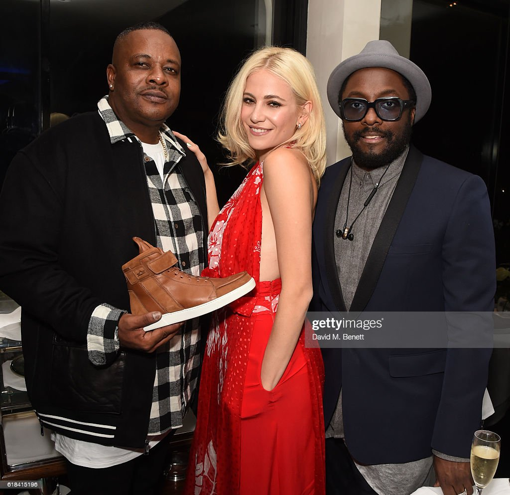 Carl Gilliam, Pixie Lott and Will.i.am attend a private dinner at Mr Chow hosted by will.i.am and brother Carl Gilliam to celebrate the launch of their luxury sneaker collection MCCVIII (TWELVEOEIGHT) at Harrods on October 26, 2016 in London, England.