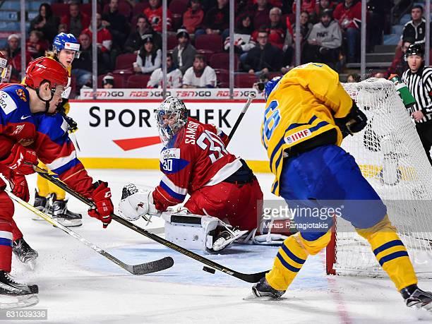 Carl Grundstrom of Team Sweden misses his shot on goaltender Ilya Samsonov of Team Russia during the 2017 IIHF World Junior Championship bronze medal...