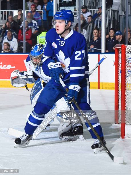 Carl Grundstrom of the Toronto Marlies gets in front of goalie Mike McKenna of the Syracuse Crunch during game 6 action in the Division Final of the...