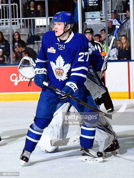 Carl Grundstrom of the Toronto Marlies puts a screen on goalie Mike McKenna of the Syracuse Crunch during game 4 action in the Division Final of the...