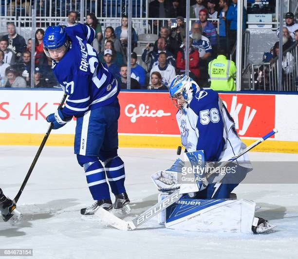 Carl Grundstrom of the Toronto Marlies tips a shot at Mike McKenna of the Syracuse Crunch during game 6 action in the Division Final of the Calder...