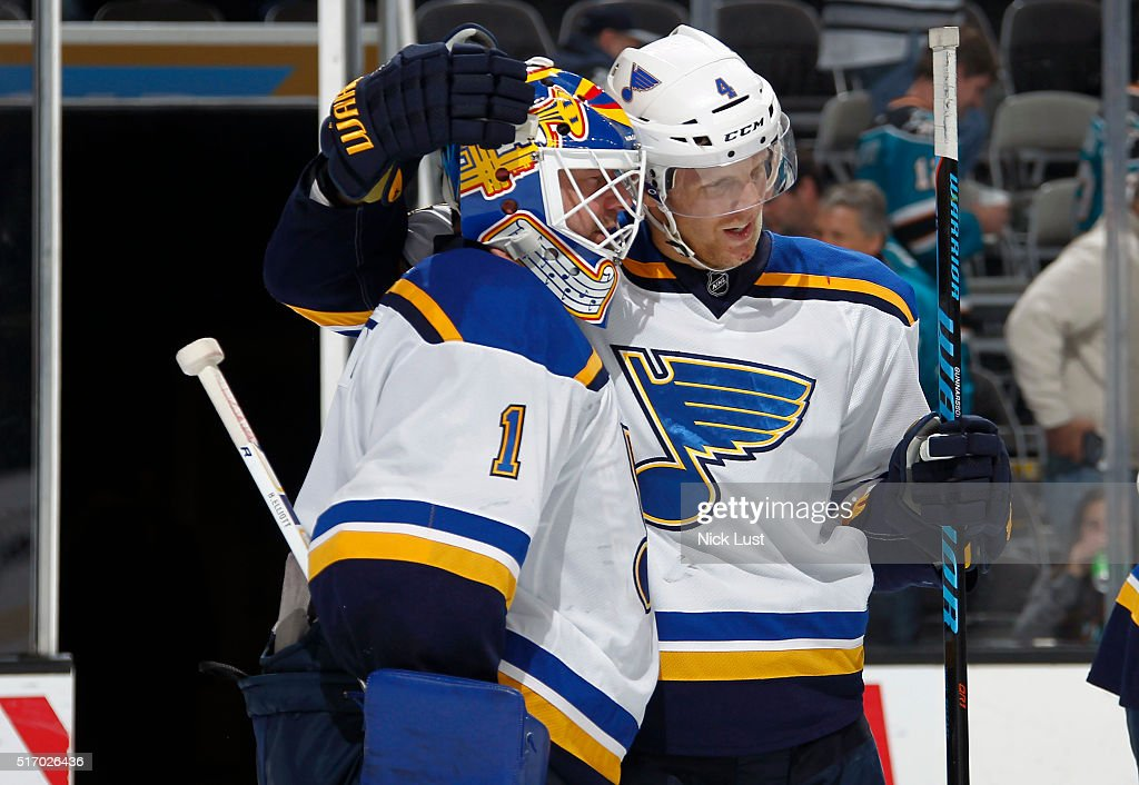 Carl Gunnarsson #4, and Brian Elliott #1 of the St. Louis Blues celebrate after Elliott's shutout against the San Jose Sharks during a NHL game at the SAP Center at San Jose on March 22, 2016 in San Jose, California.