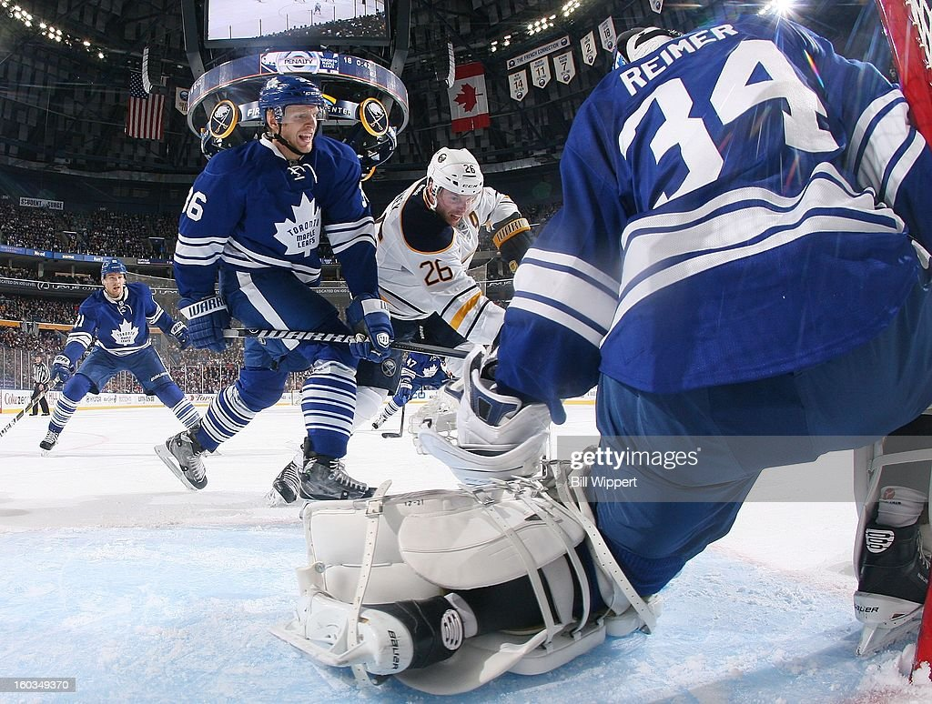 Carl Gunnarsson #36 and goaltender James Reimer #34 of the Toronto Maple Leafs defend against Thomas Vanek #26 of the Buffalo Sabres on January 29, 2013 at the First Niagara Center in Buffalo, New York.
