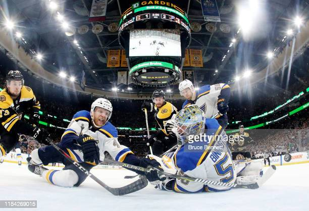 Carl Gunnarsson and Jordan Binnington of the St Louis Blues defend the goal against the Boston Bruins during the third period in Game Five of the...