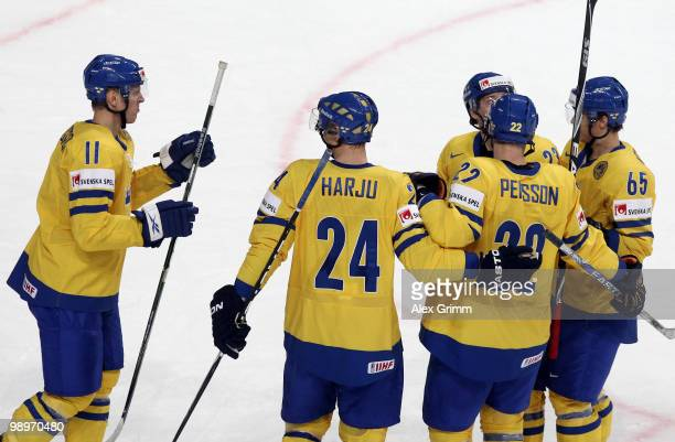 Carl Gunnarsson of Sweden celebrates his team's first goal with team mates during the IIHF World Championship group C match between Sweden and France...