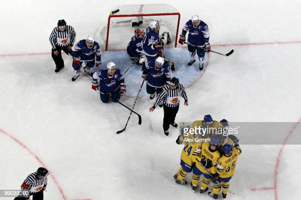 Carl Gunnarsson of Sweden celebrates his team's first goal with team mates as players of France react during the IIHF World Championship group C...