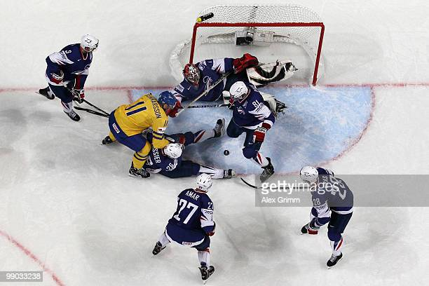 Carl Gunnarsson of Sweden scores his team's first goal against goalkeeper Eddy Ferhi of France during the IIHF World Championship group C match...